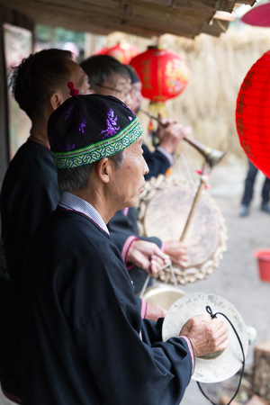 thai musical instrument: Chiang Mai, Thailand - January 11, 2017: Thailand hill tribe playing traditional music show for tourist in Highland people discovery museum in Chiang Mai, Thailand on January 11, 2017 Editorial