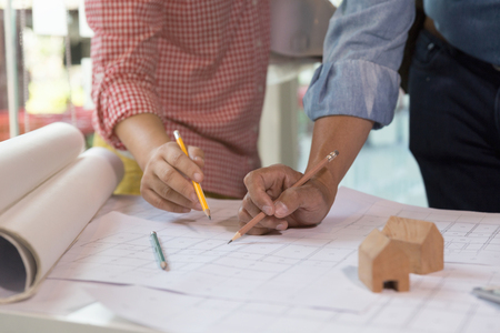 architect tools: engineer meeting for architectural project, working with partner and engineering tools at workplace. Architect working on blueprint. Construction concept. Stock Photo
