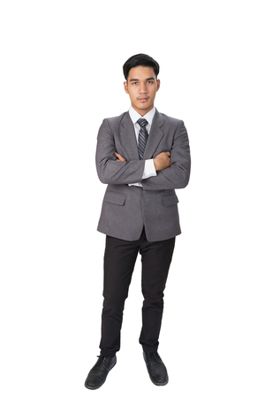 young asian handsome male startup entrepreneur businessman wearing gray suit standing with folded arms over white background Stock Photo