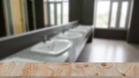 Commercial bathroom for washing hands. washbasins public toilets with selected focus wood table for montage or display your product Stock Photo