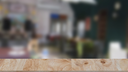 Empty wooden table space platform and blurred resturant or coffee shop background for product display montage Stock Photo