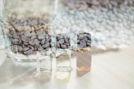 glass of coffee for taster to smell and taste aromatic and flavor wheel. art of aroma perception in brewed coffee double exposure with roasted bean. cupping examination. Stock Photo
