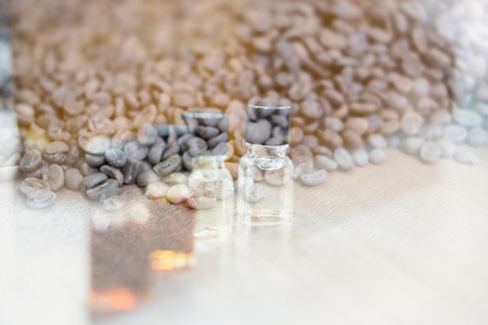 coffee tasting with reference flavor. art of aroma perception in coffee. bottle of fragrance for taster to smell aromatic double exposure with roasted bean. Stock Photo