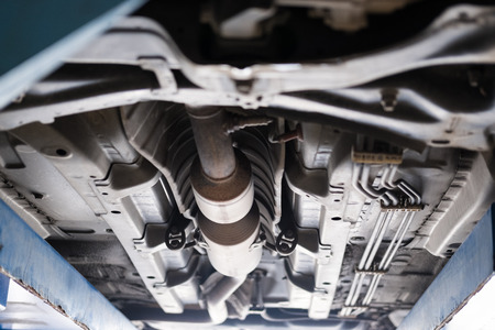 undercarriage of a car in garage. vehicle maintenance in auto repair service shop. automobile annual checkup.  fixing, checking concept Banque d'images