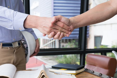 engineer handshaking for successful deal in construction plan. young architect shake hand for agreement in new business project at workplace.