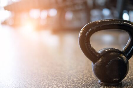 black metal weight in gym. kettlebell in health club. fitness, training, healthy lifestyle concept