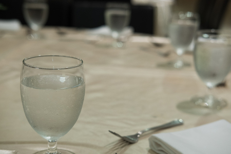 glass of water on table.  food court, cafeteria, modern restaurant interior. Stock Photo