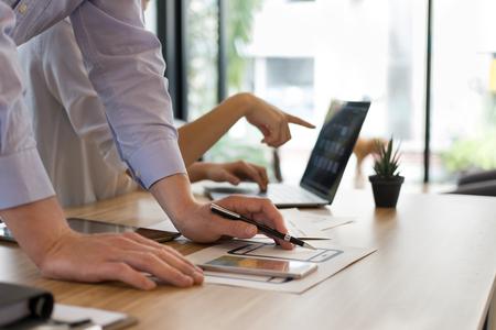user experience (UX) designer designing web on smart phone layout. UI teamwork planning mobile application. developer work with business prototype