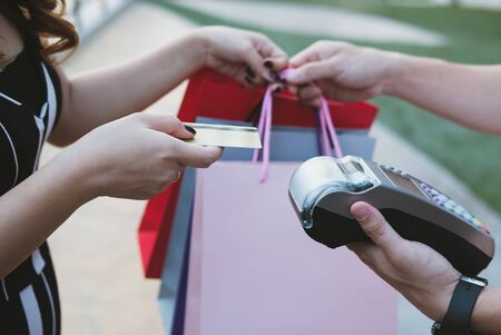 woman make payment with credit card swipe through terminal. customer paying with EDC or swiping machine. buy and sell product or service Stock Photo