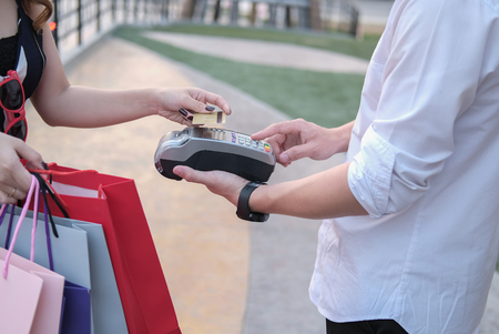 man make payment with credit card swipe through terminal. customer paying & entering code with EDC or swiping machine. buy and sell product or service