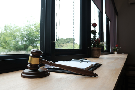 legal law gavel & notebook on wood table. lawyer attorney justice workspace