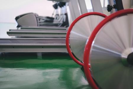 stationary bike, treadmil & elliptical cross trainer in fitness center sport gym interior Stock Photo