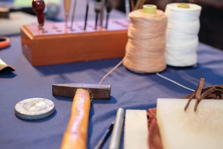 handmade leather craft DIY instrument tool. craftsman working desk