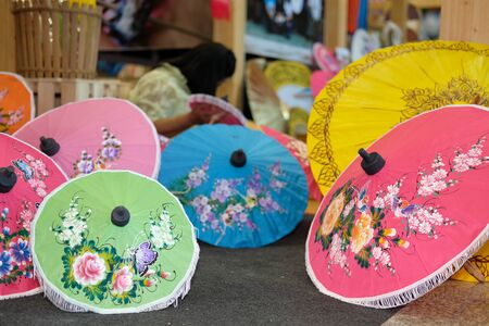 Chiang Mai, Thailand - September 9, 2018: colorful paper umbrella with painting showing at unseen lanna expo at Chiang Mai International Exhibition and Convention Centre in Chiang Mai, Thailand on September 9, 2018. Redakční