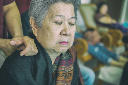 physiotherapist massage old senior woman shoulder
