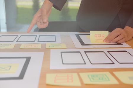 user experience, UX designer designing web on smart phone tablet layout. UI planning mobile application. developer work with business prototype