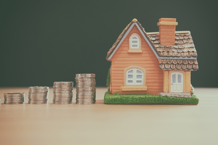 house model & coins stack. saving money for buying house property. real estate investment finance & banking