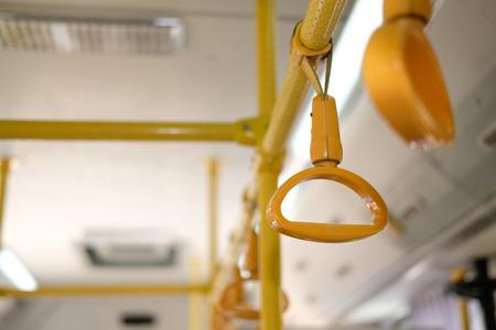 yellow handle on commuter bus. public transport