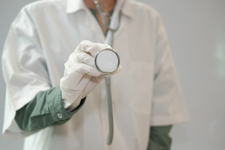 physician doctor medical practitioner with stethoscope to auscultate breath or checkup at clinic hospital