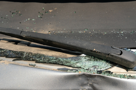 broken damaged rear car glass by accident. stealing criminal incident.