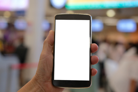 hand holding mobile smart phone at airport terminal
