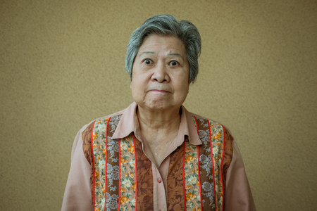 portrait of furious elder woman. enraged elderly female. angry asian senior Stock Photo