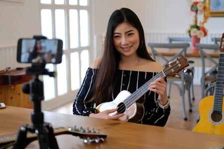blogger live broadcasting music instrument tutorial on social media. vlogger recording online vlog video. influencer marketing