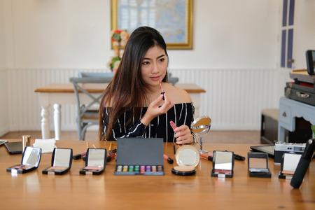 beauty blogger live broadcasting cosmetic makeup tutorial on social media. vlogger recording vlog video. influencer marketing