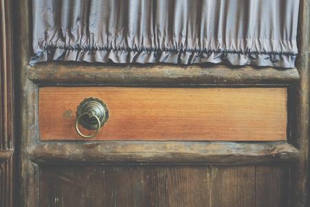old vintage yellow wooden door & retro metal handle knocker doorkhob