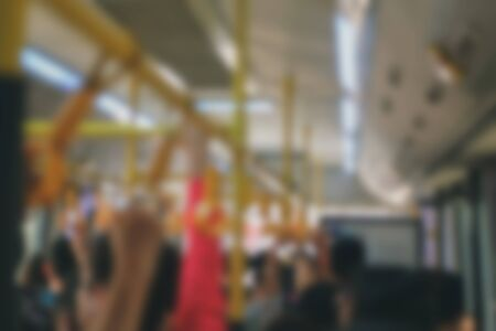 passenger riding on commuter bus. people travelling by public transport. blurry background