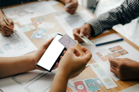 user experience UX designer designing web on smart phone layout. UI planning mobile application. developer work with business prototype Foto de archivo