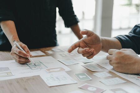 user experience UX designer designing web on smart phone layout. UI planning mobile application. developer work with business prototype Stock Photo