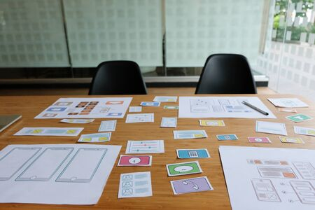 user experience UX designer designing web on smart phone layout. UI planning mobile application. developer work with business prototype Фото со стока