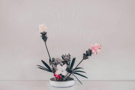 siam tulip flower arrangement in japanese ikebana style