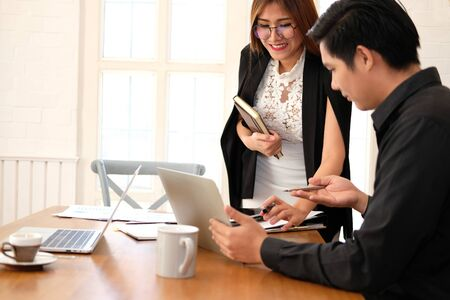 executive businesswoman advising analyzing discussing business project with co-worker team Stockfoto - 129708479