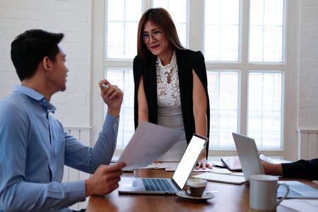 executive businesswoman advising analyzing discussing business project with co-worker team Stockfoto
