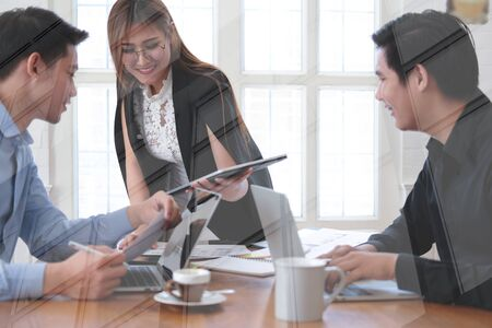 executive businesswoman advising analyzing discussing business project with co-worker team Stockfoto - 129708693