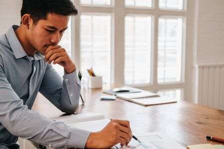 startup businessman working with document at office. man entrepreneur analyze financial data at workplace. Stockfoto - 129708890