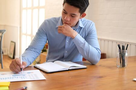 startup businessman working with document at office. man entrepreneur analyze financial data at workplace.