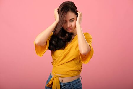 studio portrait of asian woman in casual clothing feeling sad unhappy stressed depressed Stok Fotoğraf