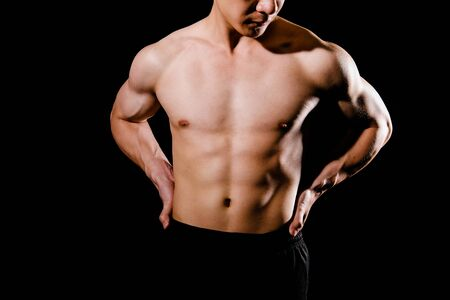 portrait of athletic muscular bodybuilder man with torso six pack abs. fitness workout concept