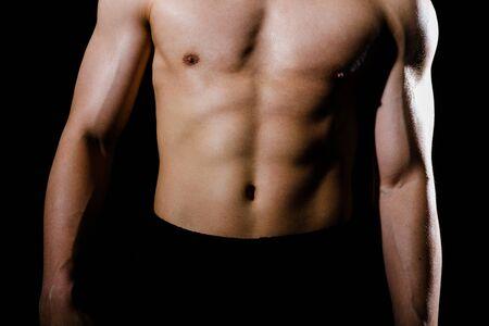 retrato de hombre atlético culturista musculoso con torso six pack abs. concepto de entrenamiento de fitness Foto de archivo