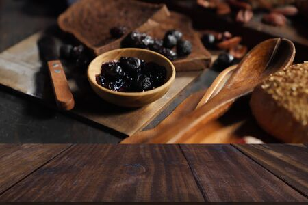 dried prunes, bacon, bread pastry bakery. baked homemade food in dark tone