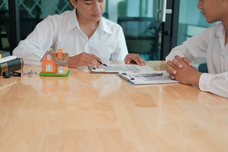 lawyer insurance broker consulting giving legal advice to customer about buying renting house. financial advisor with mortgage loan investment contract. realtor selling real estate property