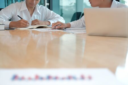 financial adviser analyzing performance revenue with investor. business people discussing in meeting. businessman working with co-worker team.