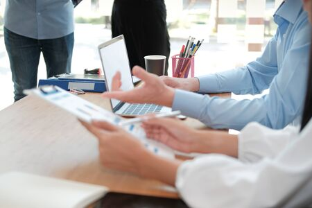 business people discussing on performance revenue in meeting. businessman working with co-worker team. financial adviser analyzing data with investor. Stockfoto