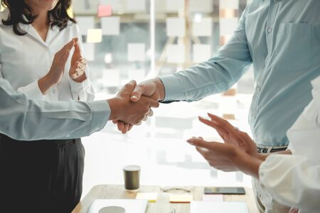 businessman shaking hands after meeting. Business people handshaking. Greeting deal, teamwork partnership concept. Reklamní fotografie - 135126904