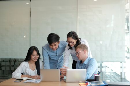 business people discussing on performance revenue in meeting. businessman working with co-worker team. financial adviser analyzing data with investor.