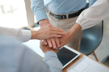 businessman businesswoman joining united hand, business team touching hands together after complete a deal in meeting. unity teamwork partnership corporate concept. Reklamní fotografie - 135126987