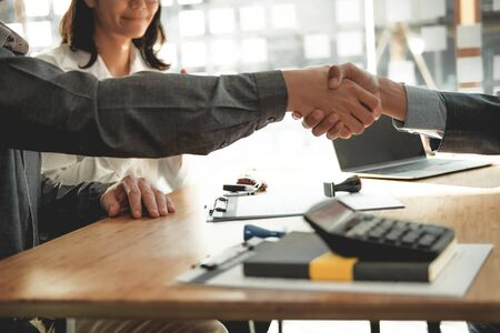 couple customer shaking hands with insurance mortgage broker lawyer realtor. client handshaking financial advisor bank worker making sale purchase deal